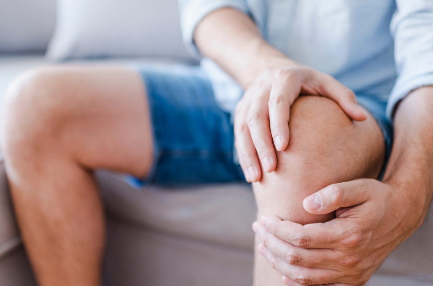 Man suffering with knee pain
