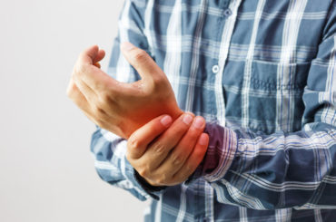 Man with pain in hand from arthritis